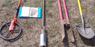 Picture of commonly used septic maintenance tools in a line